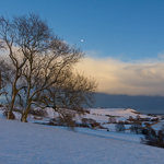 Moonrise on a wintery Stone Cliff
